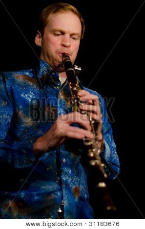 VANCOUVER, CANADA - FEBRUARY 9: jazz band Tambura Rasa. Lucas Moore (Turkish clarinet) on the stage of The Jazz Cellar on February 9, 2011 in Vancouver, Canada.