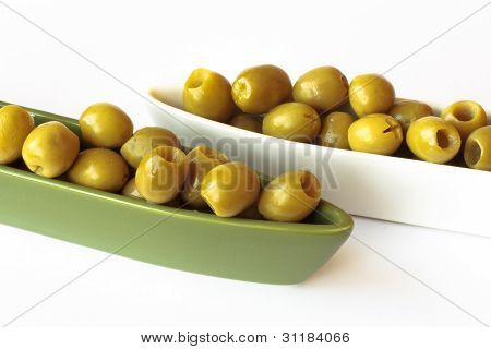 Green Olives In Two Ceramic Bowls On White Background