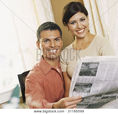 Woman sitting on lap of husband
