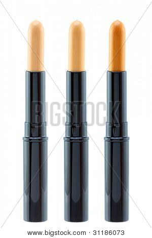 Closeup photo of a concealer stick to conceal under-eye circles or facial blemishes, isolated on white