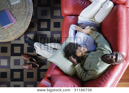 Man and woman relaxing on couch