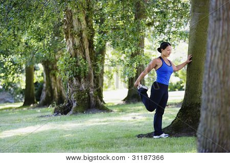 Woman in park stretching