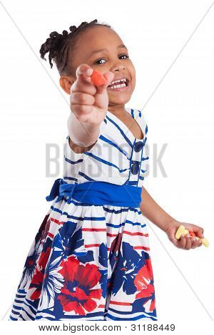 Portrait Of A Cute Little African American Girl Eating Candy