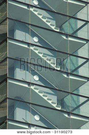 Modern glass and steel staircase on high rise building.