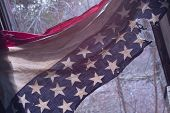 Photo of american flag destroyed.