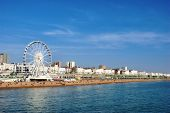 picture of beachfront  - Panoramic view along Brighton Beachfront with the promenade and Ferris Wheel backed by highrise buildings - JPG
