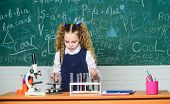 Biology Equipment. Biology Education. Little Kid Learning Chemistry In School Lab. Happy Child Girl. poster