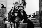 Halloween Family Photos. Skeleton Posing With Parents. Halloween Party At Home. Witch Hat. Holiday H poster