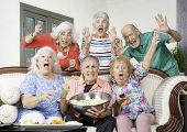Six Excited Senior Friends Reacting To Television poster