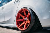 Lowrider Custom Tuned Sport Car Wheel With Small Rubber Tyre And Large Disk, Close Up poster