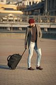 Adjust Living In New City. Traveler With Suitcase Arrive Airport Railway Station Urban Background. H poster