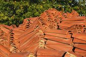 Terracotta Orange Tiles From Natural Materials For The Roof. Curved Ceramic Tiles. Roofing Construct poster