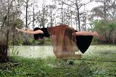 Woman Floating Above A Swamp