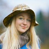 picture of fisherwomen  - beautiful girl with long blond hair fishing - JPG