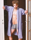 Man Confident Lover Near Door. Sexy Bachelor Lover Concept. Guy Attractive Lover Posing Seductive. S poster