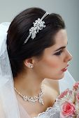 A brunette is beautiful in a wedding-dress, wedding decoration