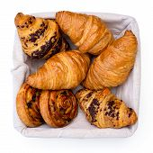 Plain And Chocholate Croissants And Rasin Danish Pastry Swirls In Linen Basket Isolated On White Fro poster