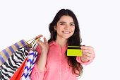 Woman Holding Shopping Bags And Credit Card. poster