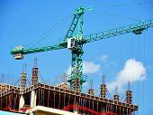 Crane. Self-erection Crane Near Concrete Building. Construction Site. Industrial Background. poster