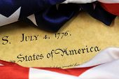 pic of preamble  - Constitution of the United States and American Flag, We The People... ** Note: Shallow depth of field - JPG