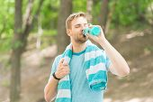 Water Is Indispensable For Human Health. Fit Athlete Having A Drink From Water Bottle During Trainin poster