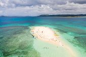 People Relax On A Tropical Island And Swim In The Lagoon. Naked Island, Siargao. Tourists Came To Th poster