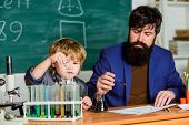 Teacher Man With Little Boy. School Lab Equipment. Father And Son At School. Using Microscope In Lab poster