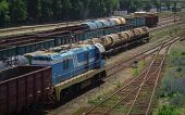 Switcher Or Shunter Moves Along The Railway Tracks In Ust-kamenogorsk (kazakhstan). Freight Wagons A poster