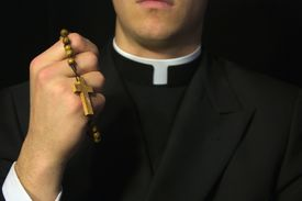 pic of priest  - Young Priest Praying With Rosery In His Hands - JPG