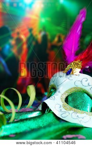 Carnival mask with a party background