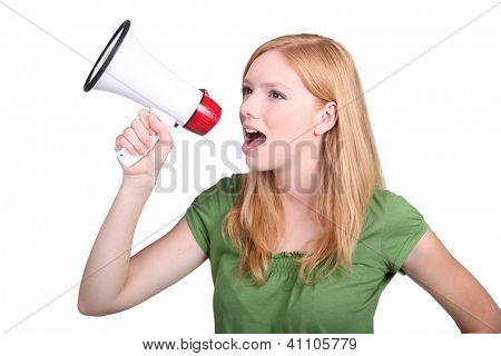 Young woman with a loudspeaker