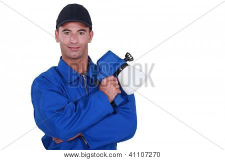 Man holding paint sprayer