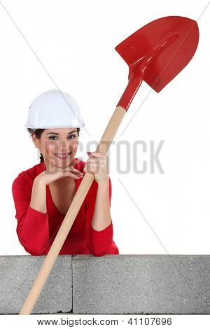Female mason smiling on white background