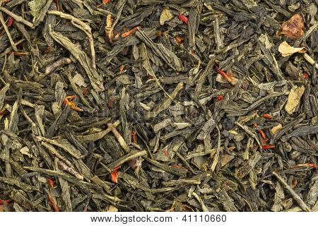 background texture of loose leaf green tea with apple fruit and safflower