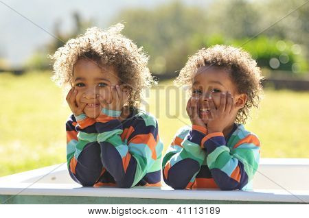 Two Young Mixed Race Children In Bathtub