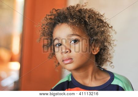 Young Mixed Race Boy With Curly Hair