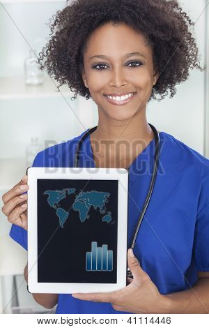 An African American female woman medical doctor holding a tablet computer in hospital with a world map and graph graphics on the screen