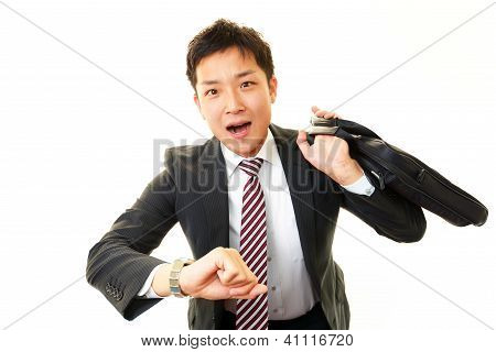Businessman realizing he is late