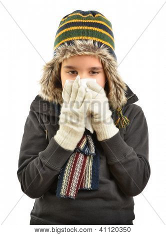 Little child sneezes into a tissue isolated on white background