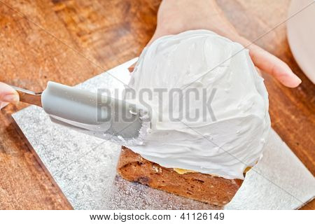 Spreading Cream On Cake With Spatula