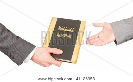 Man And Woman Holding A Marriage Almanac