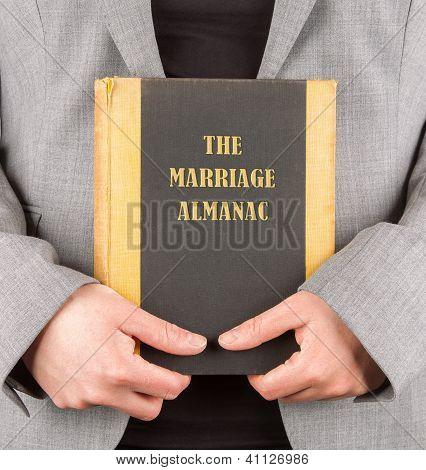 Woman Holding A Marriage Almanac