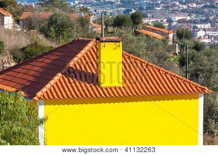 Exterior Of Bright Yellow Rural House