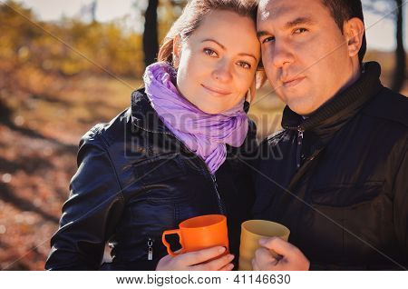 Young Family Drinking Coffee Outdoors