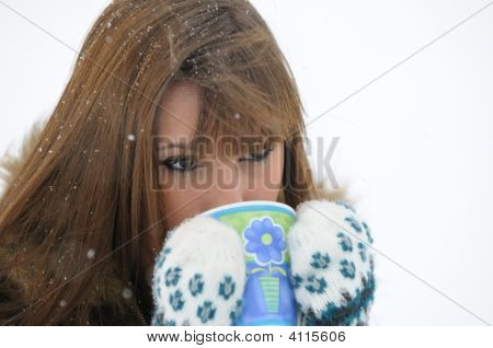 Girl With A Hot Drink In The Snow