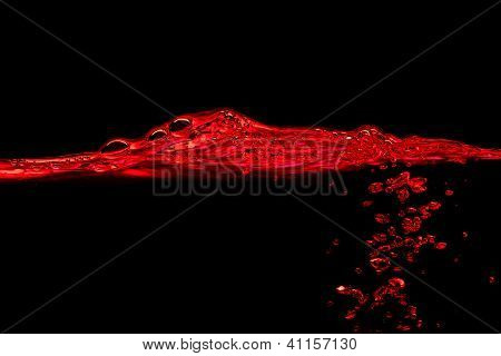 Red water wave and splash on a black background