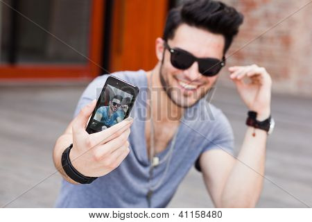 Young Male Model Making Self Portrait With A Smartphone