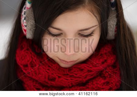 Girl Wearing Earplugs Outdoors In Winter
