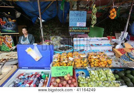 CHIANGMAI - NOVEMBER 30: Fresh fruit vendor waits for tourists at the Doi Suthep Temple in ChiangMai, Thailand on November 30, 2012. Food and tourism industry is a major income earner for Thailand.