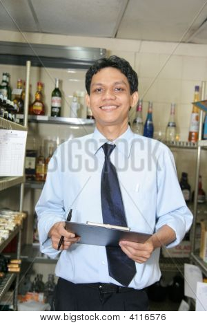 Store Keeper At Work Smiling